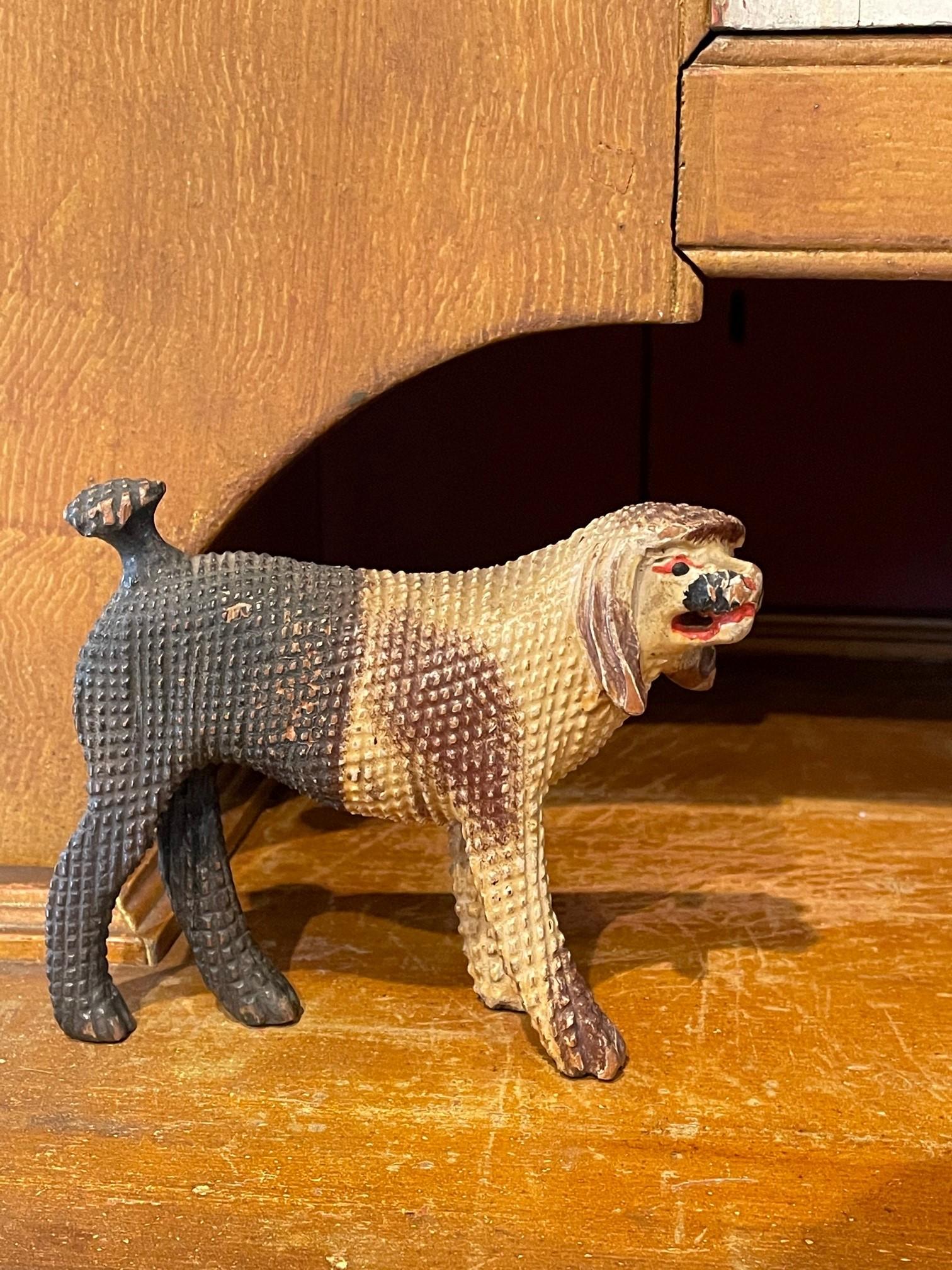 folk art carving of poodle rel=