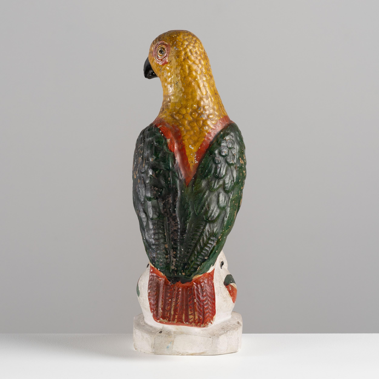 antique painted chalkware parrot rel=