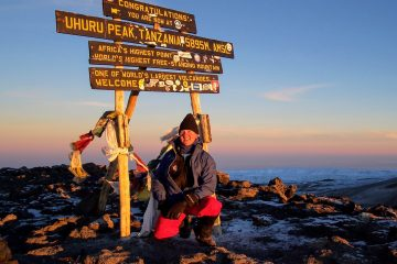 Henry Malmgren at the summit of Mt. Kilimanjaro