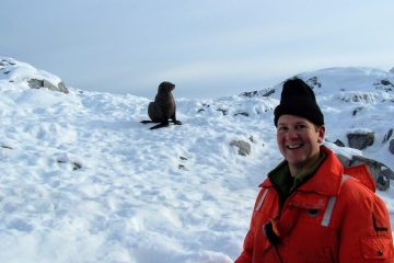 Henry Malmgren poses with a fur seal on Christine Island Antarctica