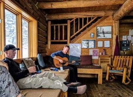 John Krhovjak plays guitar.