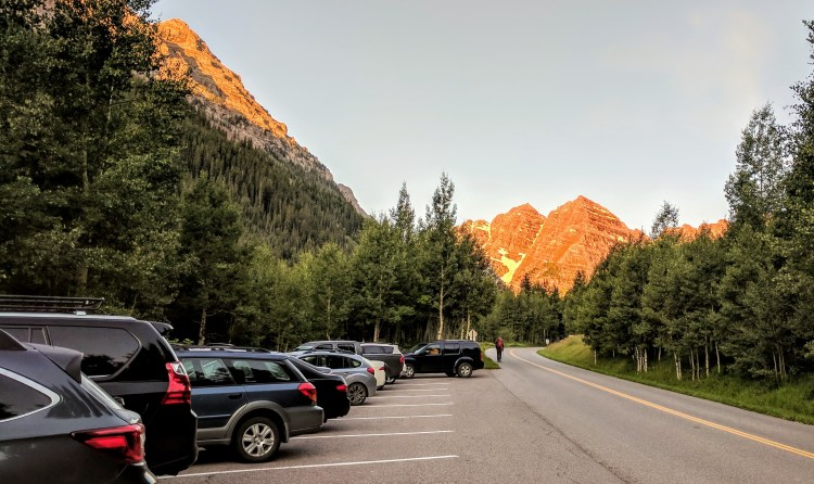 Maroon Bells with parking lot in the foreground.