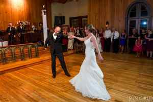 first-dance-live-stream-old-glory-ranch-indoor-reception-hill-country-venue-sun-gold-photography