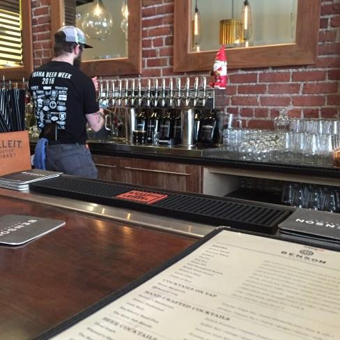 Ben behind the Benson Brewery bar