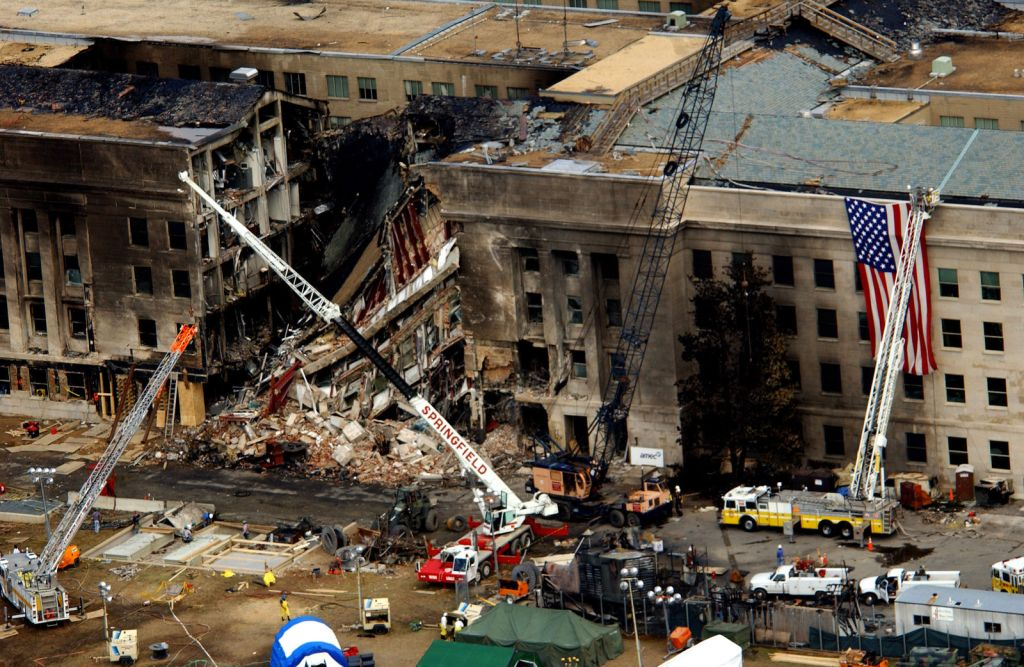 0 1 0 9 1 4 - F - 8 0 0 6 R - 0 0 3    FBI agents, fire fighters, rescue workers and engineers work at the Pentagon crash site on Sept. 14, 2001, where a high-jacked American Airlines flight slammed into the building on Sept. 11.  The terrorist attack caused extensive damage to the west face of the building and followed similar attacks on the twin towers of the World Trade Center in New York City.   DoD photo by Tech. Sgt. Cedric H. Rudisill.  (Released)