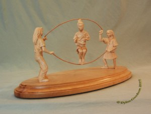 Girls jumping rope carved by dylan goodson