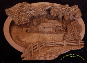 pictorial relief scene of the Mabry Mill, carved by dylan goodson