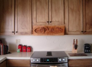 Dylan Goodson's pictorial relief scene stove hood installed in the kitchen