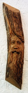 Wood Spirit carved into half a log