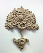 Clay model of Dylan Goodson's Yoga Tree of life woodcarving