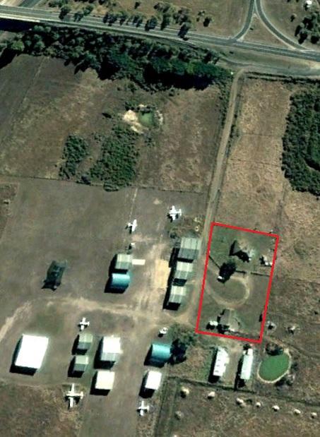 Dairy farm amidst airfield buildingss