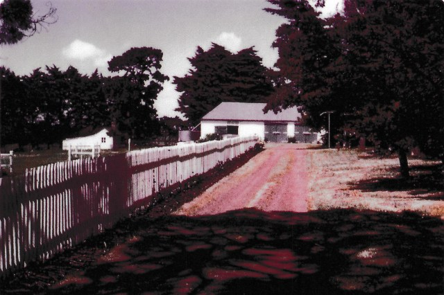 White picket fence leading to the house at Mac'sfield