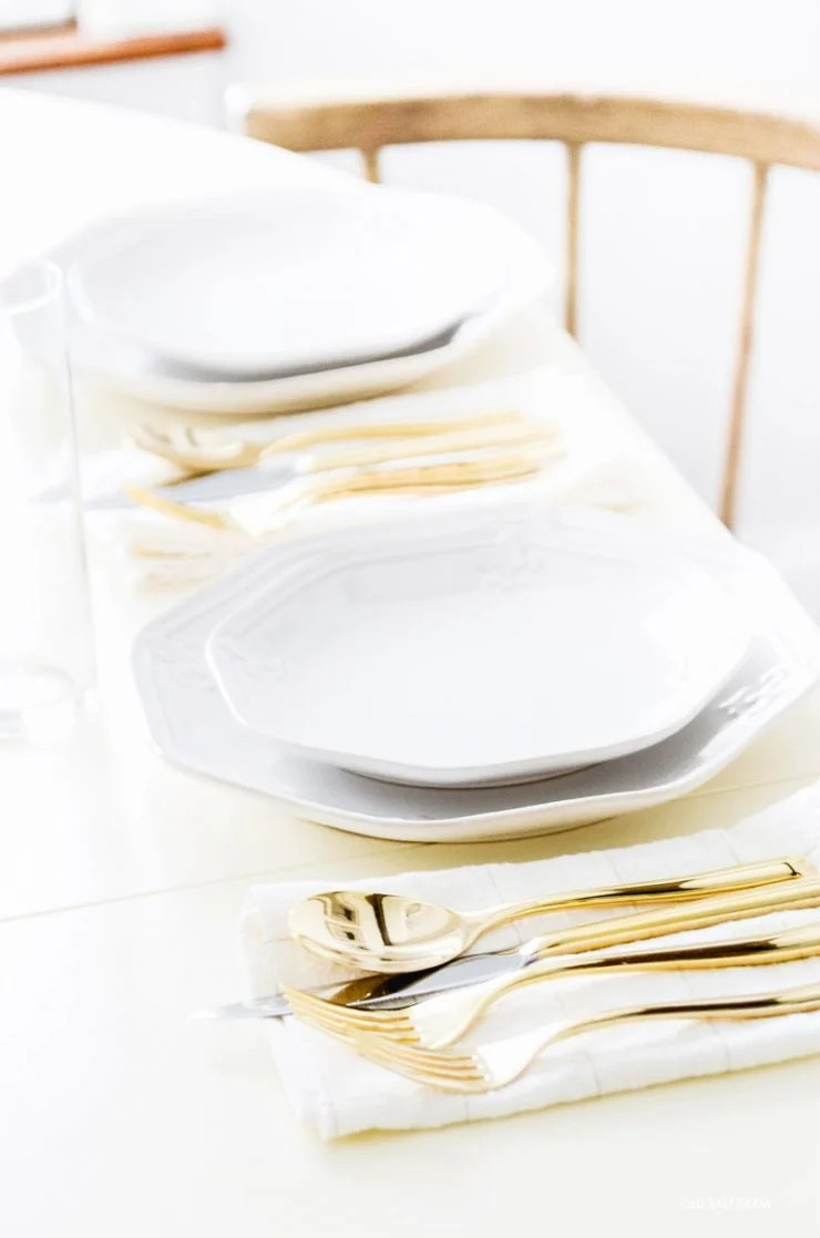gold-flatware-white-dishes