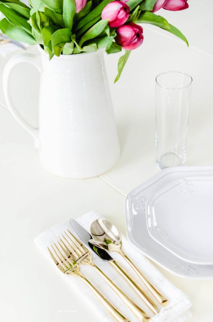 gold-flatware-white-dishes-tulips