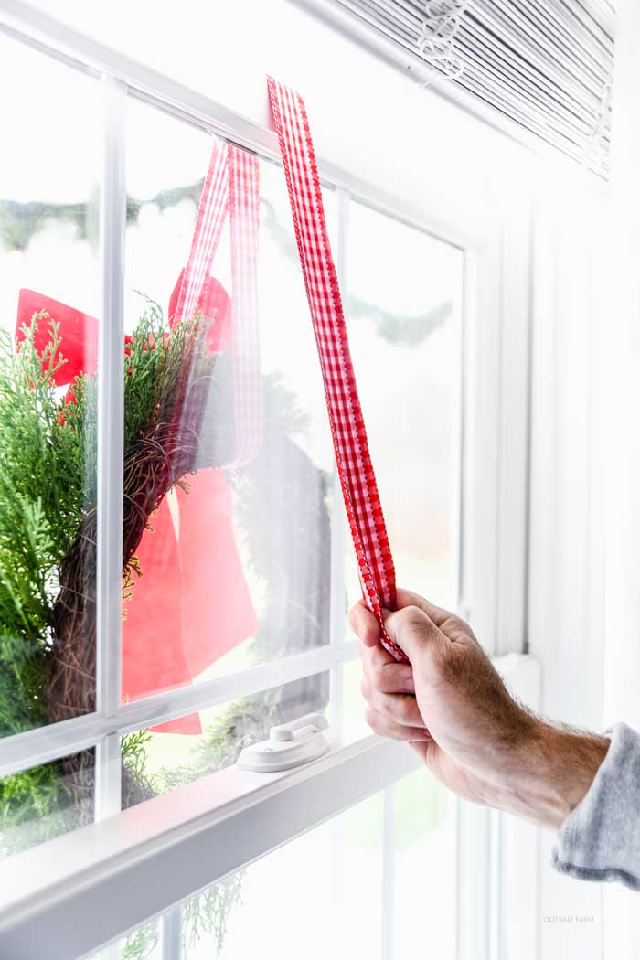 The EASY Way to Hang Christmas Wreaths on Exterior Windows