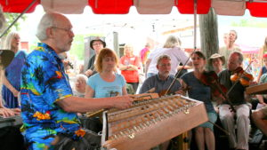photo of Bill Spence playing the Hammered Dulcimer