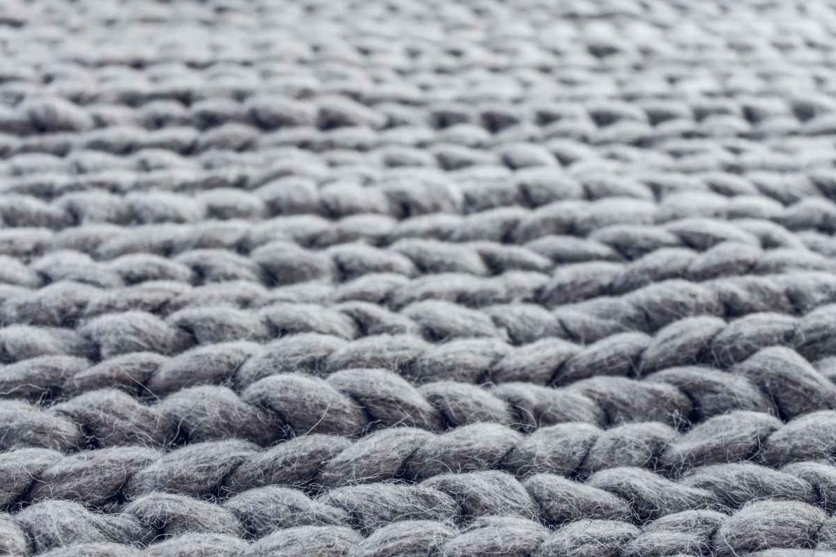 close up of gray cable knit cloth