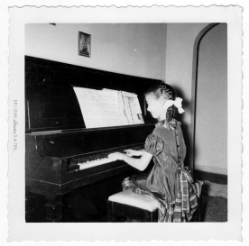 Judy at the old upright 1951