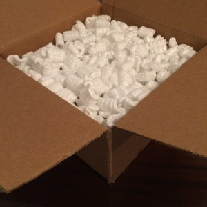 "The sandwiched record is ""floated"" securely in packing peanuts."