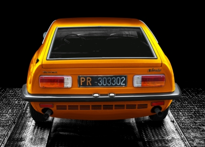 Maserati Indy in black & orange, rear view