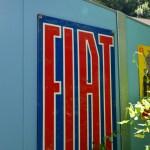 Boxenstop Ammer-Terrasse mit Logo FIAT an der Aussenmauer