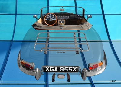 Jaguar E-Type Roadster Series I on blue windows
