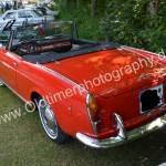 Fiat 1500 Spider in rot bei einem Oldtimertreffen in Wolfegg