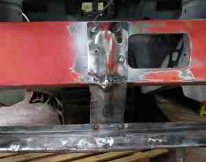 Front spoiler bracket welded in place