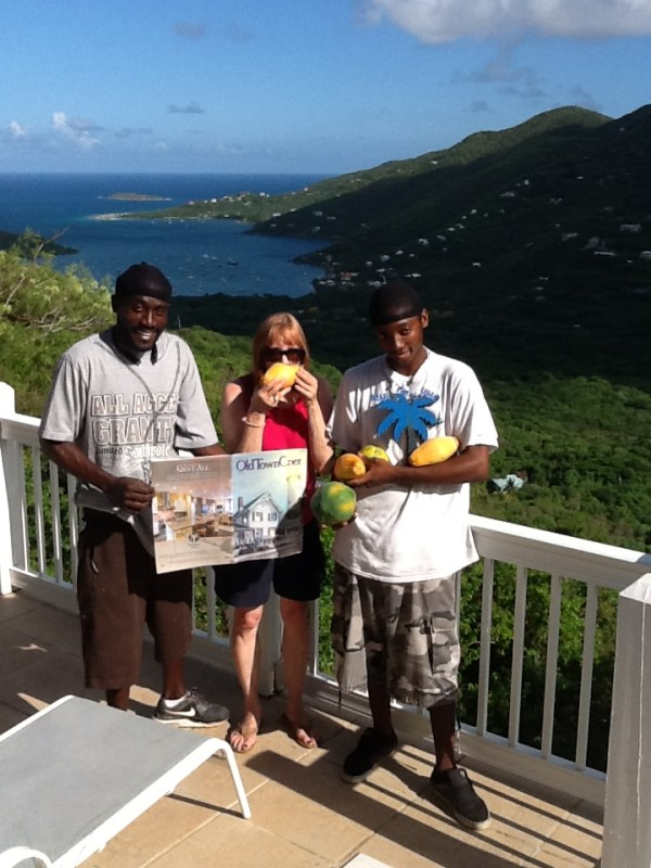 Mikki Bergman, friend of the OTC, peruses the publication with Blue Palm Villa caretaker Erickson and his helper Alie while enjoying some coconut milk fresh from the source. Alie is sporting papaya and mango also just picked on the property! Blue Palm is located in Coral Bay, St. John.