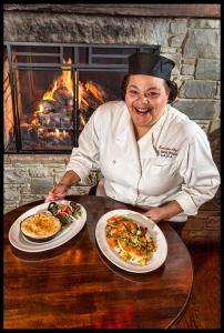 Chef Morejon with her Shepherd's Pie and Chicken Schnitzel © Chester Simpson