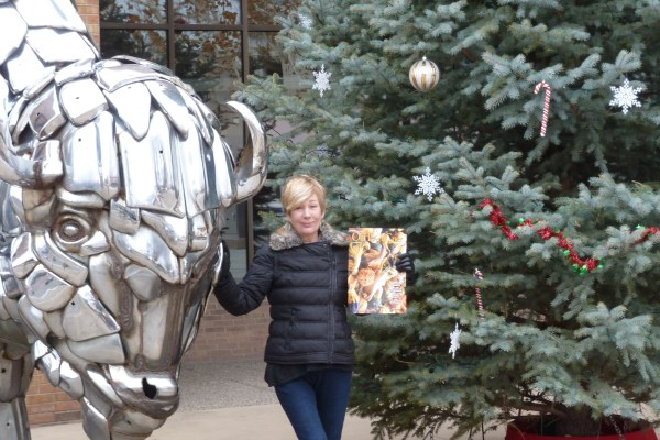 Grand Junction resident and frequent Old Town Alexandria visitor, Linda Plant Allin, takes the OTC into downtown Grand Junction. Posed here with one of the the many fantastic sculptures - Chrome on the Range - next to this year's Christmas tree.