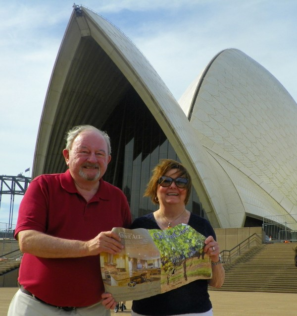 Old Town Alexandria residents, Dick and Mary Kenefick took the Old Town Crier with them to Australia on a six week circumnavigation of the continent and display it here in front of the iconic Sydney Opera House where they attended a concert.