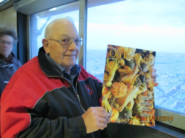 Torrington, Wyoming resident, Dick Glandt, borrowed long time Old Town Crier reader and subscriber, Donna Beth Downer's November issue and took it with him to the top of the Eiffel Tower in Paris. Dick and his wife Marilyn were in France on vacation. The OTC really gets around!