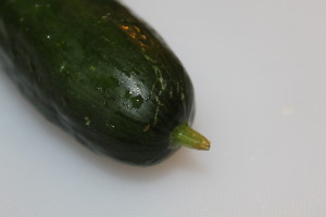 This is the cucumber's stem end - typically larger than the blossom end. The blossom end will have a small and rougher divot.