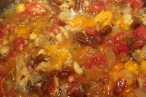 Mix tomatoes and bread with the onion mixture and let simmer