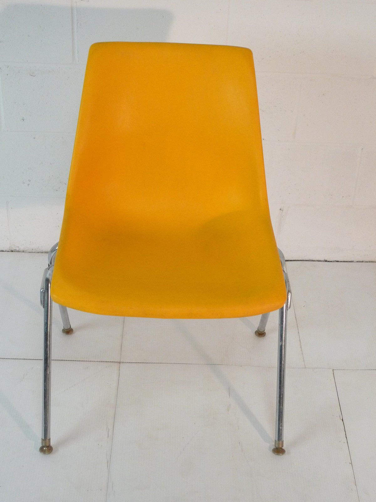 Yellow Plastic Mid Century Modern Eames Era 60s Chair