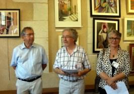 """A la Salle de l'horloge : 1er discours de Michel Bordas, président de """"Pastel en Périgord"""" entre Monsieur le maire et Leoni Duff, invitée d'honneur"""
