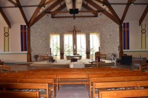 Baptismal Font in front of altar.