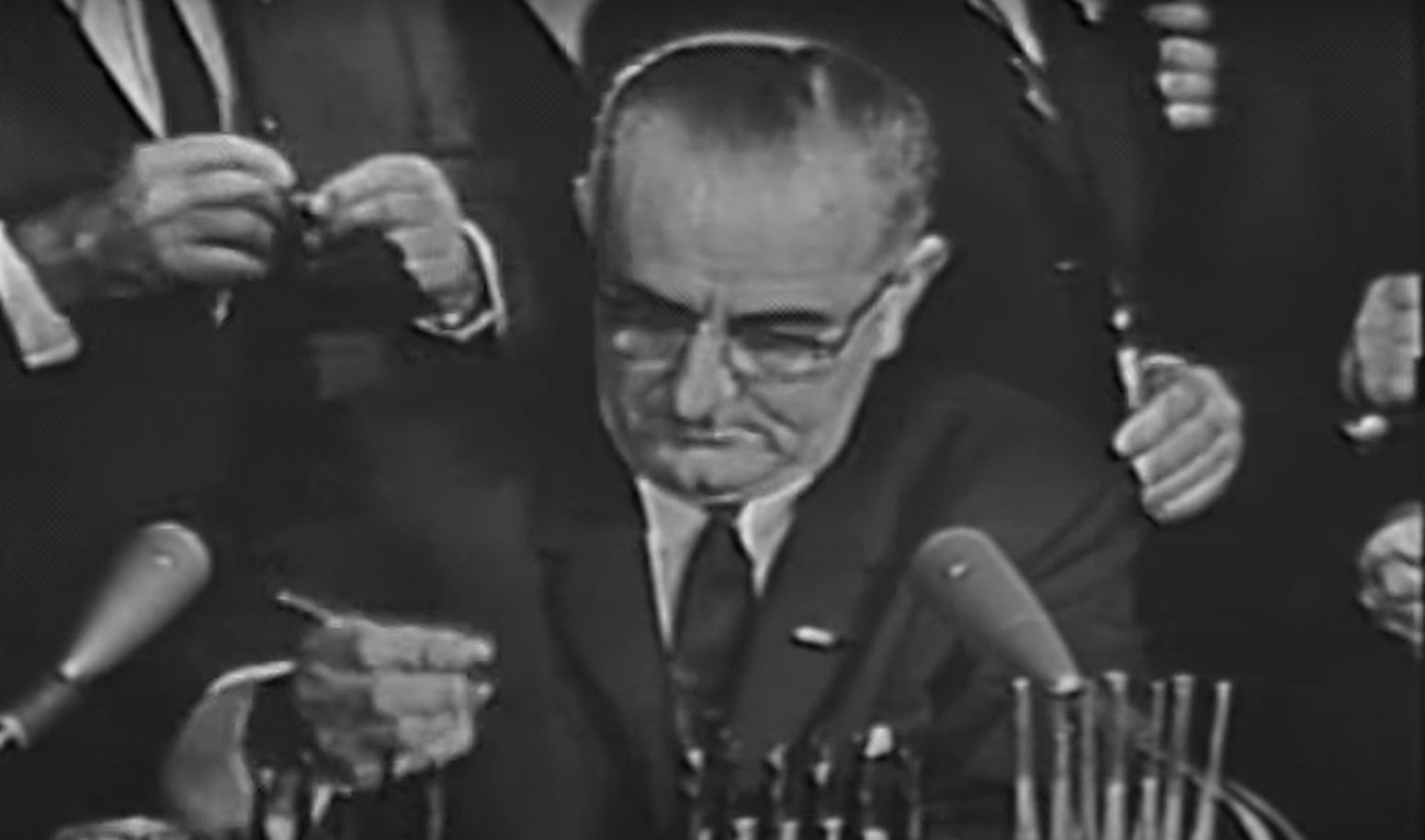 LBJ Signs Civil Rights Act