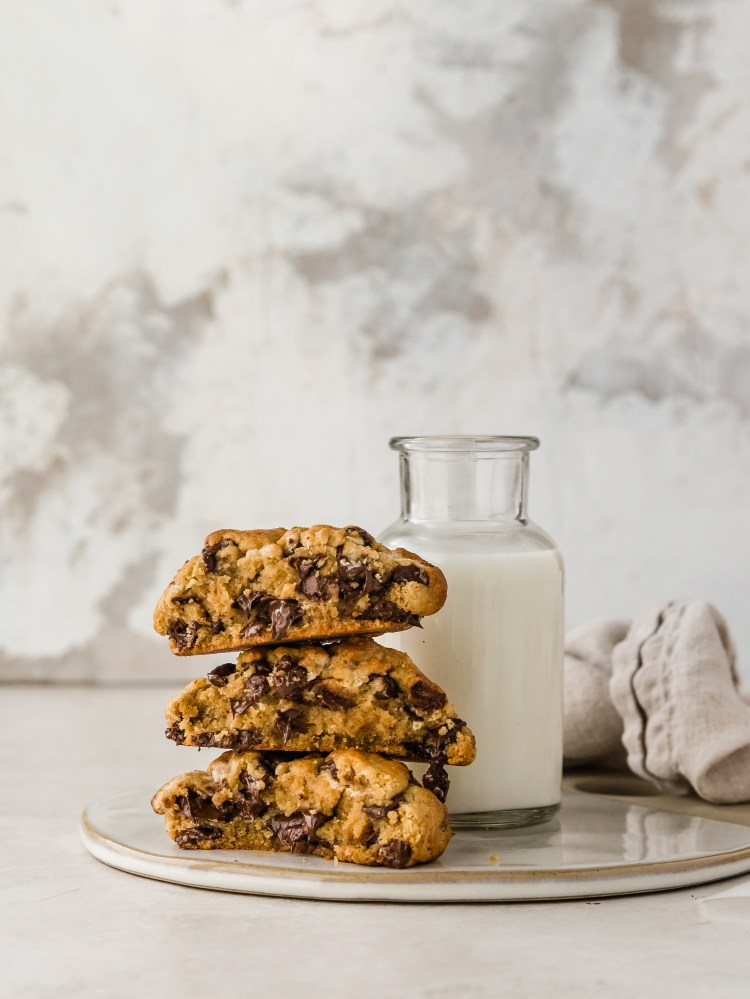 giant chocolate chip cookies made with tahini, brown butter, and halva. a fun twist on the classic inspired by levain bakery.