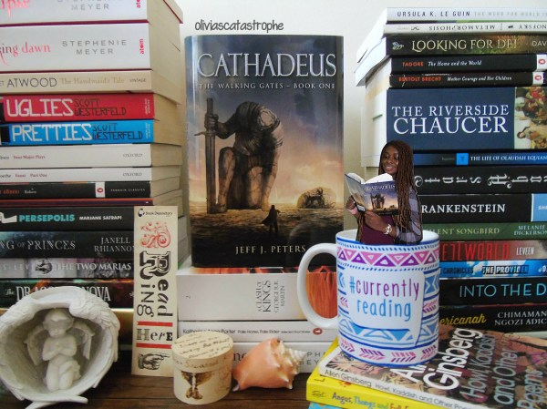 book stacks and a bookish mug with girl sitting in mug olivias catastrophe