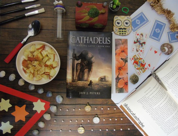 bookish flatlay with cathadeus by jeff j peters olivias catastrophe