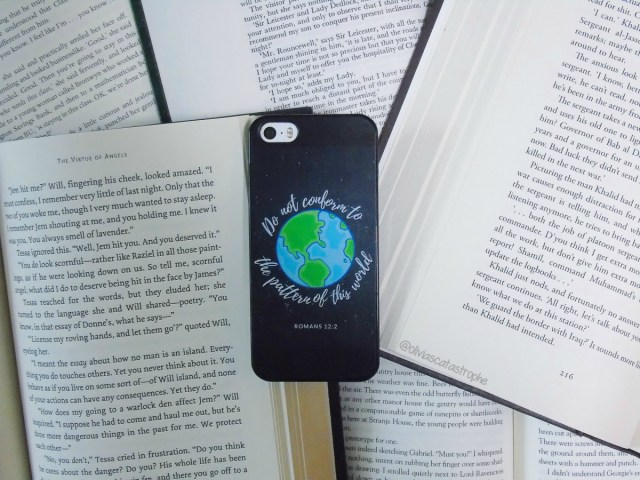 romans bible verse phone case on open books olivia's catastrophe