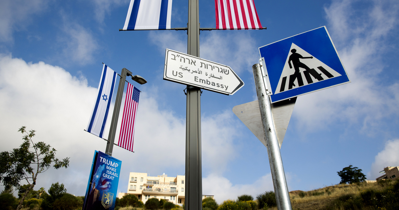 A road sign leading to the U.S. Embassy is seen ahead the official opening in Jerusalem, Sunday, May 13, 2018. Monday's opening of the U.S. Embassy in contested Jerusalem, cheered by Israelis as a historic validation, is seen by Palestinians as an in-your-face affirmation of pro-Israel bias by President Donald Trump and a new blow to frail statehood dreams. (AP Photo/Ariel Schalit)
