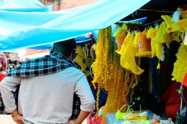 marlon perusing the market. leftover new year's eve yellow still for sale!