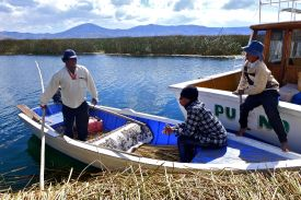 mar gearing up for the fishing trip with nestor and his son royal.