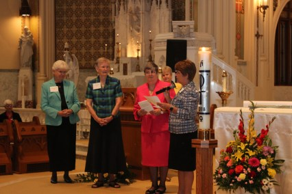 Former superior generals Sister Ann Petrus and Sister Jane Ann Slater present Dr. Melby with symbols of the Chapel transfer