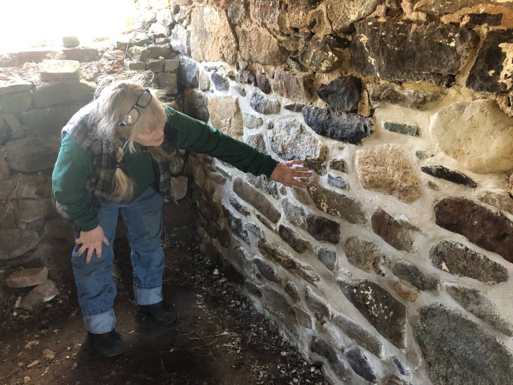 FOBH Advisory Board member Tina Kaasmann-Dunn examines repointing of the Olmsted-Beil House foundation, January 2020.