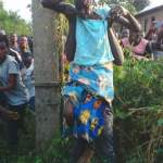 (Photos)80yrs Old Witch Gets Trapped To An Electric Pole While Flying Back From Her Mission