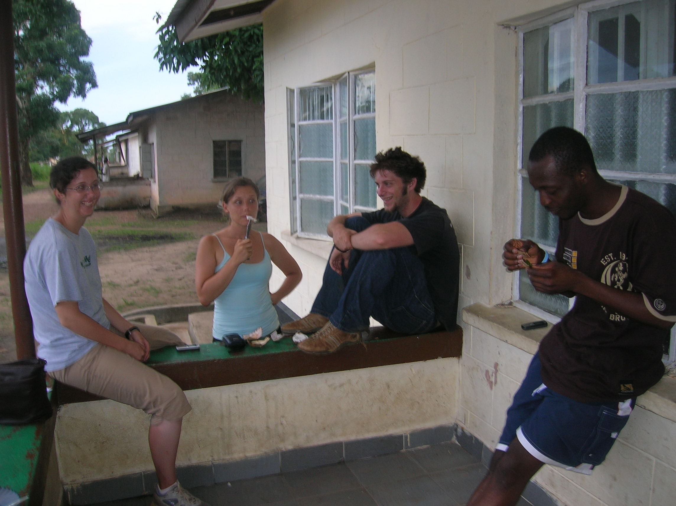 Katie, Katie, Jamie and Carlos [making a coconut whistle]